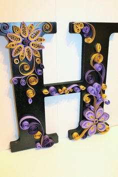 Monogram using wooden letter, paint, gold and purple quilled paper.  facebook.com/kreationsbykelsee