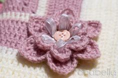 crochet flower with ribbon & a button