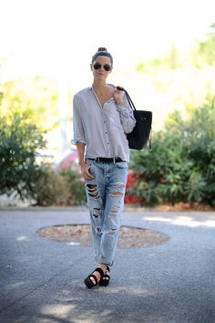 Shredded denim with a striped button down and platform sandals.