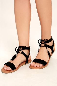The Keely Black Lace-Up Flat Sandals are perfect under that breezy maxi you've been eyeing! Soft vegan suede toe strap and ankle cuffs meet adjustable laces with tasseled ends.