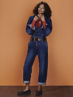 Kenyan beauty Malaika Firth looks effortlessly cool in her latest denim-clad editorial with Vogue Russia.