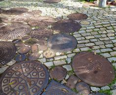 Absolutely love the idea of using old manhole covers to pave a garden path!