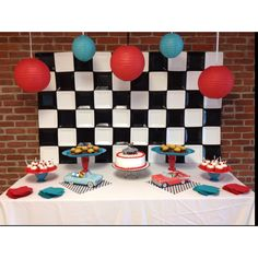 50's party - diner/classic cars theme.  I like the black and white check behind the food table