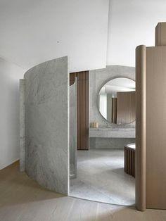 formas orgânicas em divisórias de banheiro