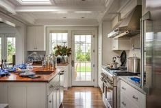 Stunning White Kitchen With French Doors