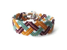 """friendship bracelet """"triple zig zag"""" I'll have to look up the pattern for this one!"""