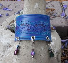 """Celtic knot painted leather cuff with dangles from my shop """"dmaulart"""" #leatherCuff #celticKnot"""