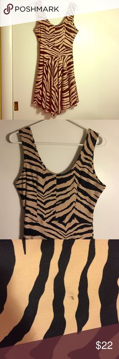 Adorable zebra skater dress! Lightly worn spandex zebra skater dress! From an online boutique called Coquetry Clothing. Very cool and comfortable on hot summer days! Skater part of dress has a few tiny makeup spots on it, shown in pic 3-4. Not at all noticeable. Size medium, size chart is listed under the Tropical skater dress listing. *PUG listed for exposure Pinup Girl Clothing Dresses Midi