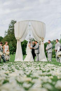 Circular chuppah draped with flowy cloth and crystal chandelier - Elegant White Gold and Platinum Cedarwood Outdoor Wedding | Historic Cedarwood | All Inclusive Designer Weddings