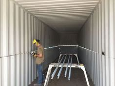 Cutting top off container for swimming pool conversion.