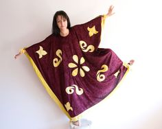 Magic Carpet costume in oxblood red and yellow, made out of plus fabrics.  Great for adults, could fit various sizes.    It measures approximately 52 (132 cm) tall and 55 (140 cm) wide    This costume is available in kids size here:  https://www.etsy.com/listing/159982990/kids-halloween-costume-aladdins-magic?ref=shop_home_active  Also available as a set of 1 adult size and 1 childrens here coming with a 10% discount as a set:  https://www.etsy.com&#x2F...