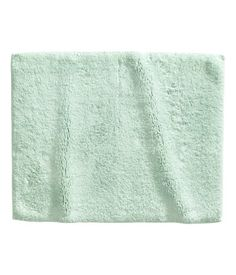 $10 Mint green. Cotton bath mat with non-slip backing.