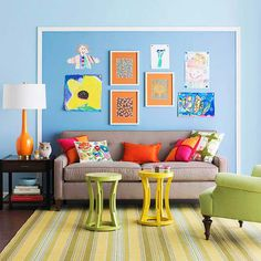love the fun colors and the square behind the sofa  Great way to display kids' art!