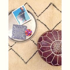 Late night inspiration! We can't get enough of mixing and matching #material #colour and #pattern Our #fluffy #beniourain goes well with #traditional #leatherpoufs and this #vintage brass tray - don't you think? #allnatural #handmade #frommoroccowithlove #morocco #berlin #inspiration #fashion #fairtrade #instastyle #instahome