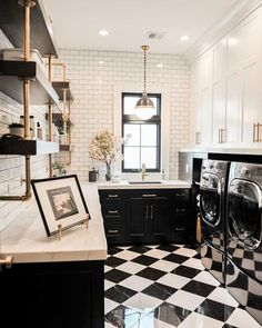 "Style Me Pretty Living on Instagram: ""#laundryroomgoals in a BIG way. Black and white floors, subway tile with dark grout, open shelving and those pendant lights? Yeah, we'd…"""