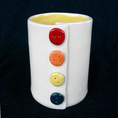 "This mug was hand-built with a porcelain slab, and is therefore light and durable.  Porcelain buttons ""sew"" it up.    This mug is 3.5"" x 2.5"".  It ..."