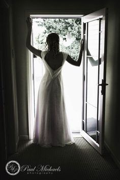 Home coverage bridal shot in the doorway.  #Wedding #photographers, #Wellington, New Zealand. http://www.paulmichaels.co.nz/