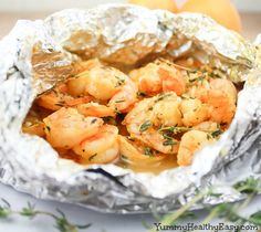 Orange-Thyme Grilled Shrimp {in foil packets} Recipe Main Dishes with large shrimp, fresh orange juice, grated orange, garlic cloves, olive oil, chopped fresh thyme, salt, pepper