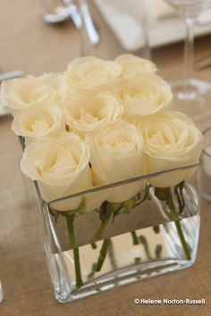 The perfect wedding centerpiece — Dollar Store square vases with 9 white roses each. Lauren, this will be gorgeous on those dark wine tablecloths you picked out. The perfect wedding… Mod Wedding, Wedding Table, Wedding Reception, Wedding Ideas, Reception Ideas, Wedding Inspiration, Trendy Wedding, Elegant Wedding, Wedding Simple