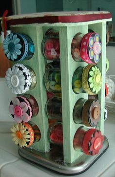 Use an old spice rack as sewing organization!  Glue a corresponding button on each top correlating to which color buttons are stored in each container. Genius idea. No tutorial.