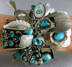 Bracelet with 56 charms | Charms include those made by Ester White (Navajo), Lolita Platero (Zuni), Helen Long (Navajo), Alberto Contreras (Navajo), Jim Paywa (Zuni) plus many more Bracelet and most of the charms are sterling silver. Predominately turquoise with the occasional coral piece incorporated into a charm