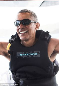 Barack Obama pictured swimming on island vacation #dailymail