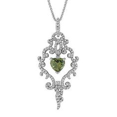 This stunning pendant is part of our exclusive One-Of-A-Kind collection and showcases one vibrant heart shaped green sapphire, at 1.51 carats TW. This gorgeous gem is accented with 127 round diamonds at .50 carat TW and is crafted from quality 14 karat white gold. The total gem weight of this distinguished pendant is 2.01 carats and the piece hangs from a matching, 18-inch adjustable wheat chain. #ShaneCoLBD