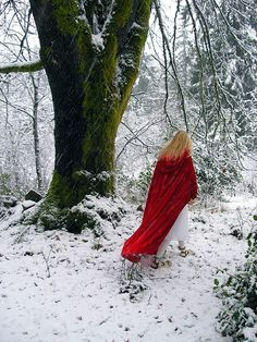 Little red riding good photo shoot in the woods ( via Brittany Haglin) [Little Red Riding walking through snowy forest.]