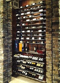 Wine rack installed in stone wine cellar for a modern and elegant look