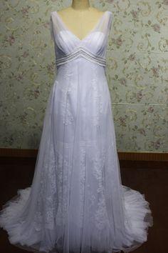 A line V neck tulle maternity wedding dress empire waist chapel train. $238.00, via Etsy.