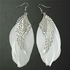 Wing/Feather Earrings NWOT New in clear packaging. Material is zinc alloy. Measures to about 10 cm in length and 3-4 cm in width Jewelry Earrings