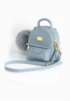 Mini backpack and shoulder bag.                                                                                                                                                                                 More