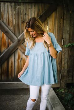 """Lightweight chambray tunic. Ruffled sleeves. Baby doll style. Oversized fit. 85% cotton, 15% polyester Hand wash only. Model is 5'7"""" + wearing a small."""