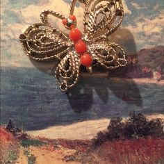 Vintage :Butterfly brooch Butterfly brooch with three faux coral stones in gold tone metal.. Collectible item. This was in the 80's. Jewelry Brooches