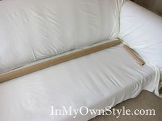 Use cardboard tubes (with rubber bands!) to keep slipcovers from coming untucked