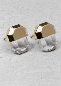 & OTHER STORIES Made from shiny metal, these stud earrings have an angular gem design with a faceted rhinestone pendant. Length: 1.3 cm. Nickel free.