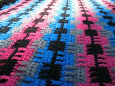crocheted afghan by curious tangles. alternating single & triple crochet stitches.