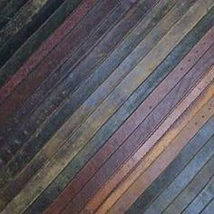 Leather flooring tiles:  made from recycled leather belts.  Also in black.  http://www.tinglondon.com