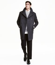 Dark gray melange. Double-breasted coat in felted wool-blend fabric with a wide collar. Handwarmer pockets, front pockets with flap, two inner pockets, and