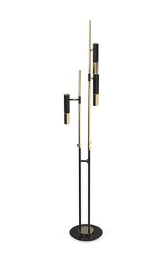 Ike standing lamp is the ideal corner piece for a lobby or a living room. It has a balanced elegance and presence. Made with architectural environments in mind, it is a classic, versatile and yet a timeless piece.  This handmade black and golden piece is made in brass and its lampshades in aluminium.