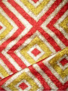 "Registan Diamond Tomato.   Tribal diamond ikat print on high luster 100% poly velvet. Beautiful multi purpose home décor fabric. V 12.5"" - H 18"" up the roll repeat. 54"" wide."