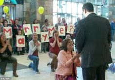 Woman stages flash mob proposal at airport arrivals gate as boyfriend returns from two-year trip (and he said yes!)