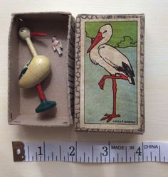 ANTIQUE-VINTAGE-OLD-STORK-TINY-WOODEN-JOINTED-DOLL-INSIDE-BOXED-DOLLS-HOUSE