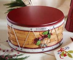 Longaberger Baskets-Music makes it merry! The Christmas holiday is rich with traditions of music and festivities. The Longaberger 2012 Christmas Collection™ Drum Basket sparkles with the energy and excitement of the season, celebrating the music that makes the season merry. Stackable with lids and generosly sized, they're perfect for displaying and storing decorations. www.shopbasketsnmore.com
