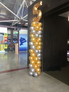 Megaloon 3.5m column. Mix of gold and silver balloons! Great for shop sales!