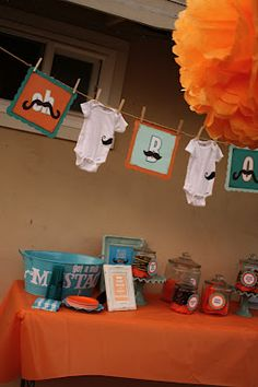 boy baby shower.. mustaches and clothes pin idea