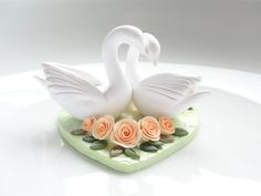 Swan wedding cake topper in peach, white and pale green shades handmade from polymer clay