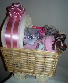 New #Puppy Carriage #Gift #Basket for #Dogs (Pink) by Purrfectly Rebarkable #Pets Congratulations! It's a new puppy! This new puppy shower gift basket for dogs comes in the form of a baby carriage, loaded with puppy gifts and treats for a new best friend! We have decorated our favorite collection of gifts for a new puppy in a wicker basket with puppy training pad wheels and a training pad canopy to give the appearance of a welcome baby carriage.