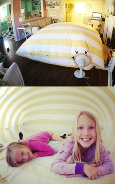 Saw this idea today on Pinterest so I thought I'd try it out. All you need is a duvet cover and a fan.  Put the fan in the cover and button around the fan.  Turn it on and you have an instant inflatable fort.  I used clamps to create a better seal around the fan.  We put bedding and pillows in and my kids have been in it all day.  Right now they're playing cards in there.