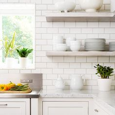 LOVE - stainless counters and subway tile back splash = Simple Charms